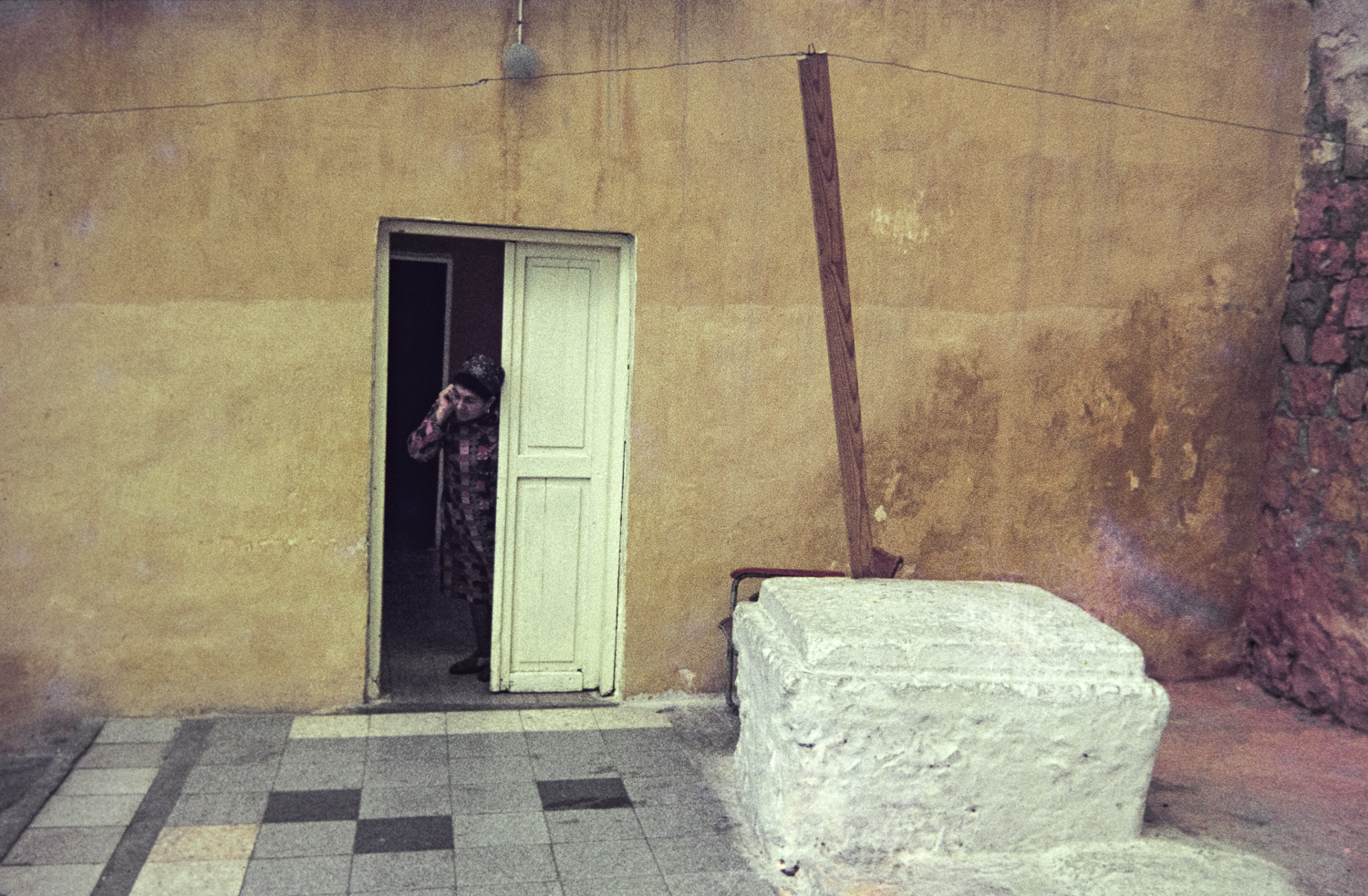 Woman in doorway - Haifa, 1977