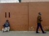 Men and wall - Johannesburg, 2006